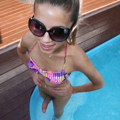 Cute and Young shemale teen Izabelly Marquesine at the pool